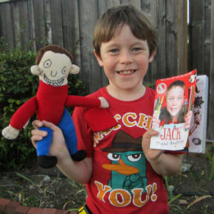 Jack with his book and a toy made for him by Brazilian company Rabisquedo
