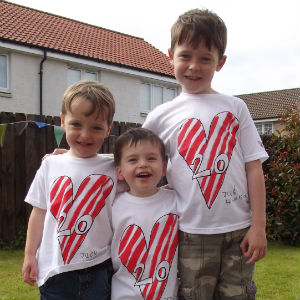 Jack, Toby & Noah wearing Edinburgh Children's Hospital Charity (previously The Sick Kids Friends Foundation) t–shirts that Jack designed