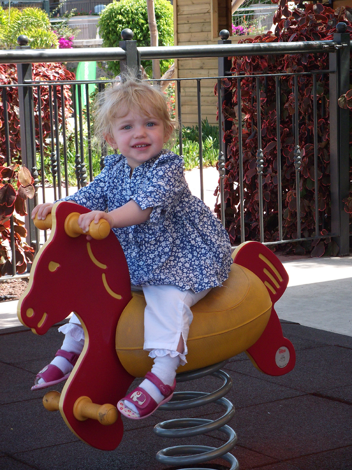 My daughter Bethany having fun on holiday playing in the park for Heather Dooley