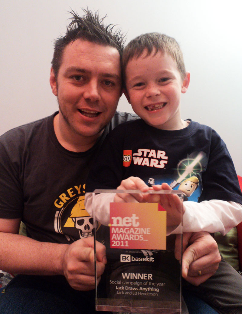 Dad Ed returns home with the award for Jack to see