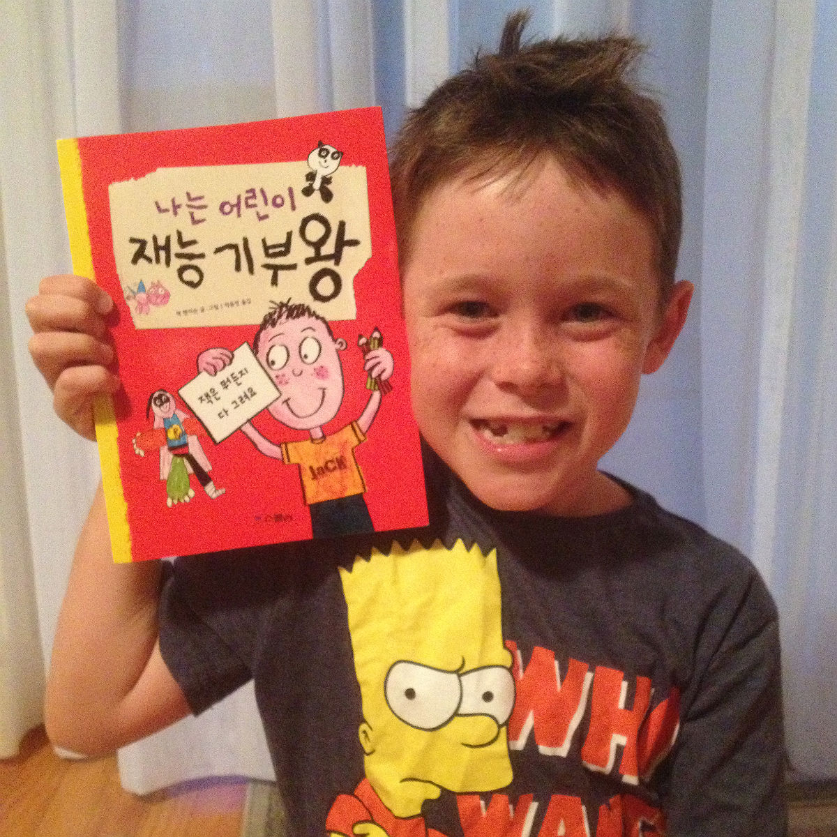 Jack with his copy of the Korean version of Jack Draws Anything