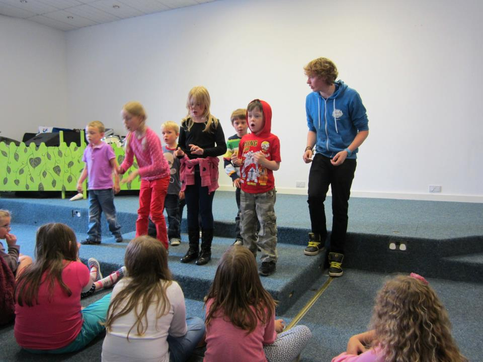 Jack on stage performing a wee play at Love Drama Camp
