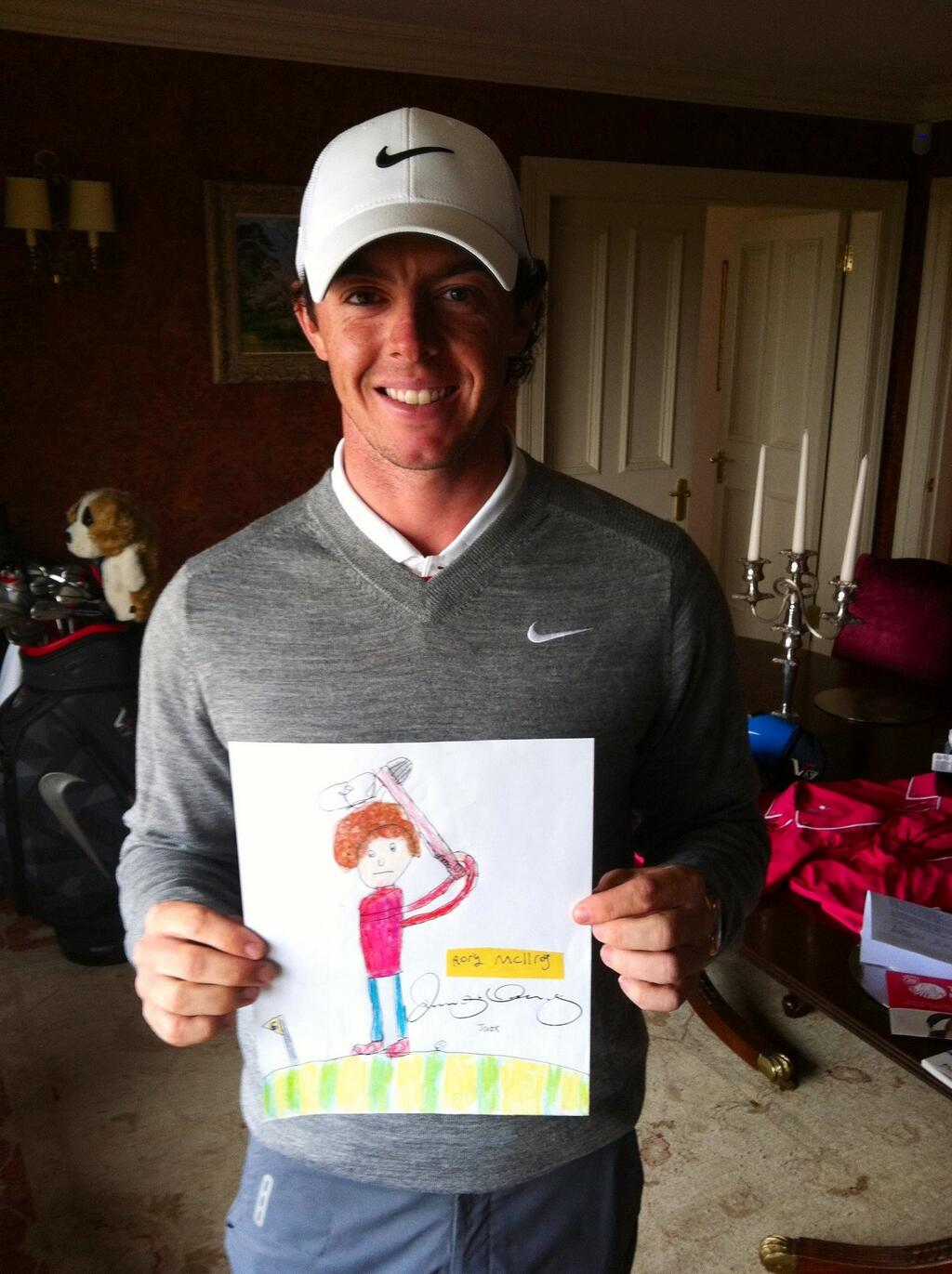 Golfer Rory McIlroy with his signed Jack Draws Anything portrait
