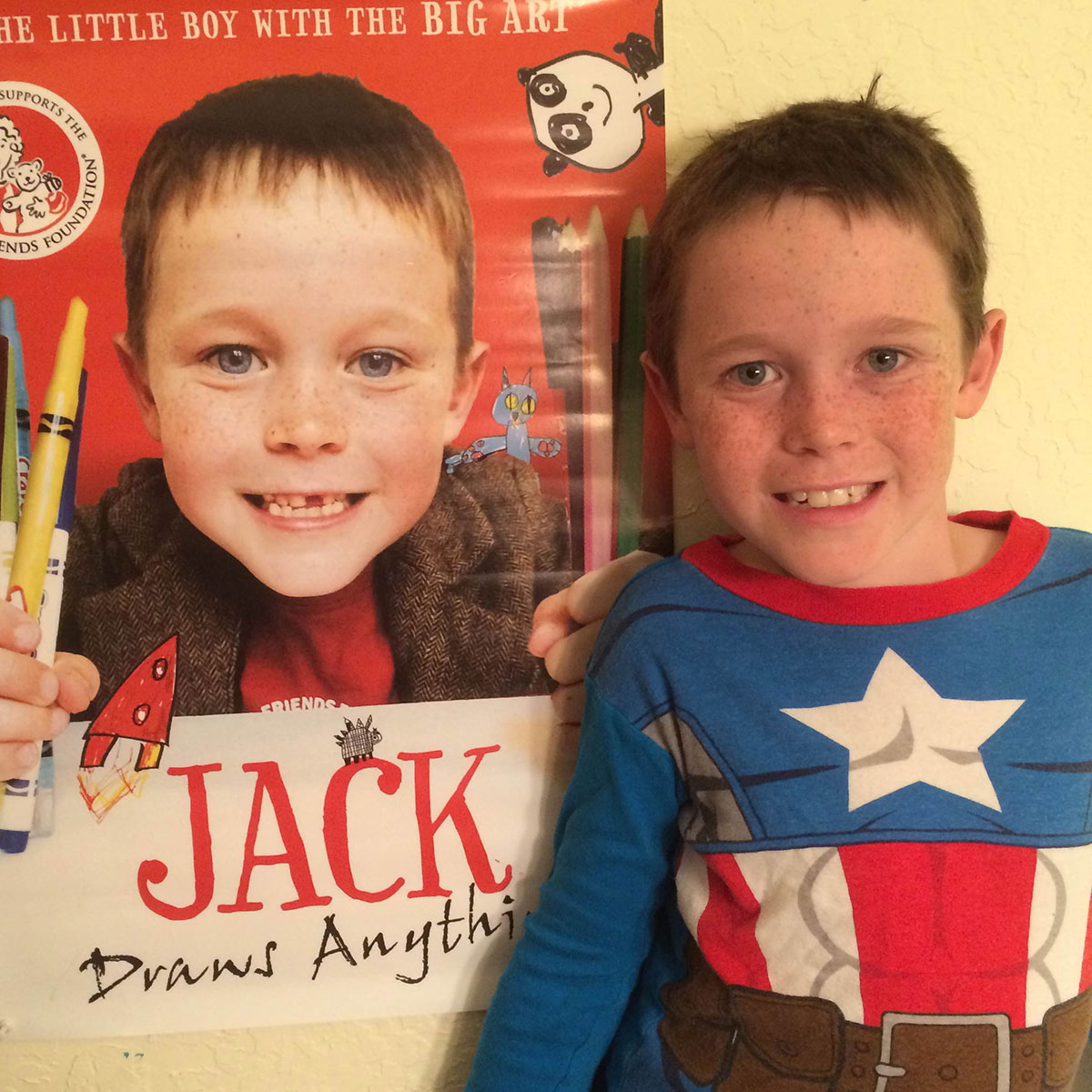 9 year–old Captain America Jack at home in California with his Jack Draws Anything poster (featuring a 6 year–old Jack)! (Photo by ED HENDERSON)