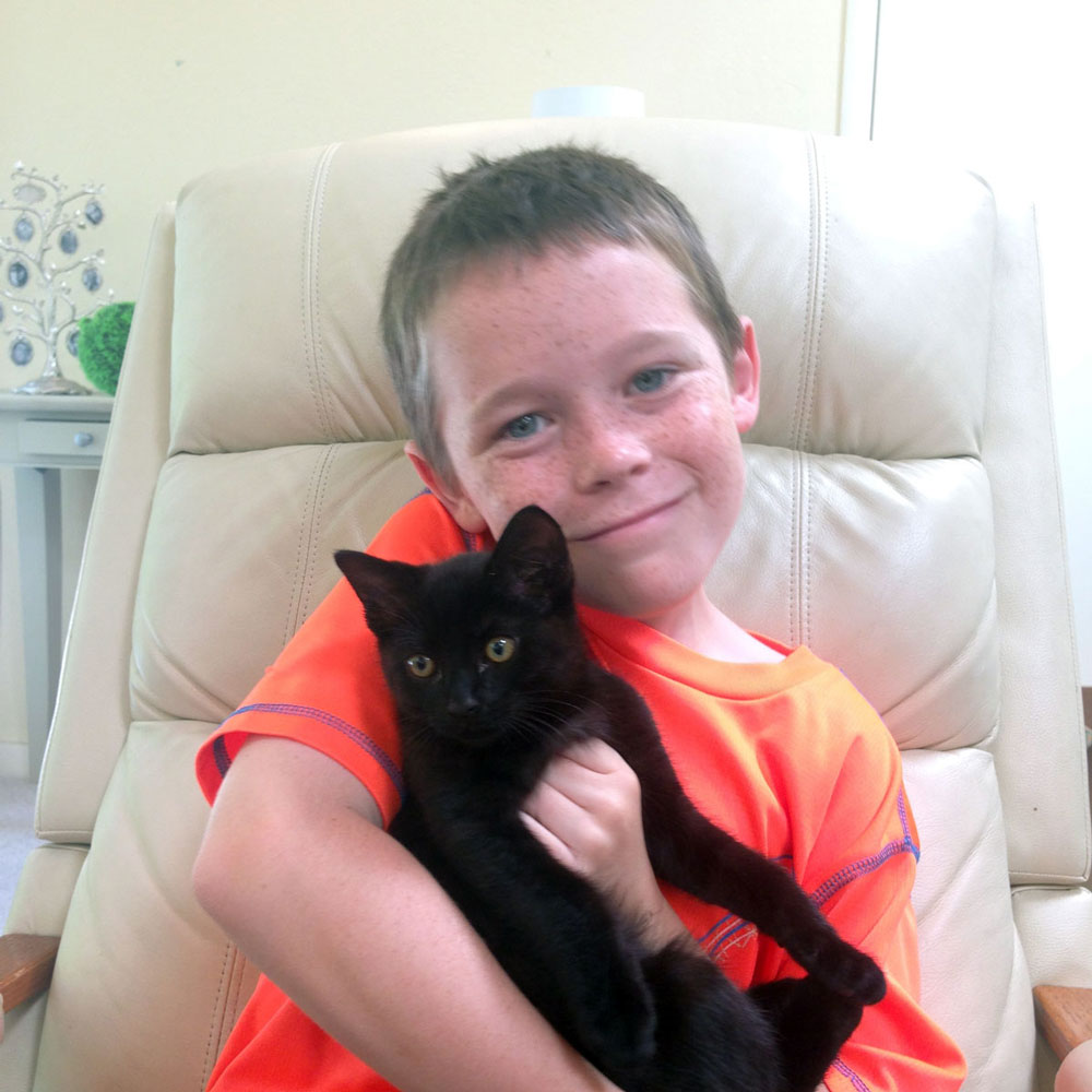 Jack says goodbye with new cat Oscar (Photograph by Rose Henderson)